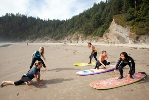 A group of women prepare to learn surfing in Oswald West State Park. Photo by Justin Bailie.